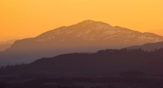 sunset rays on creag dubh, newtonmore, from Ord Ban, Strathspey