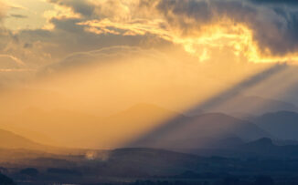 Beams of light over Strathspey from Ord Ban