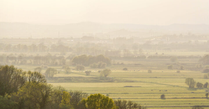 View across Somerset from Dundon hill in hazy sunset light