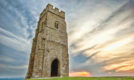Glastonbury Tor with dramatic evening cloudscape