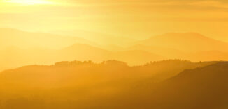 Misty goln sunset rays across strathspey