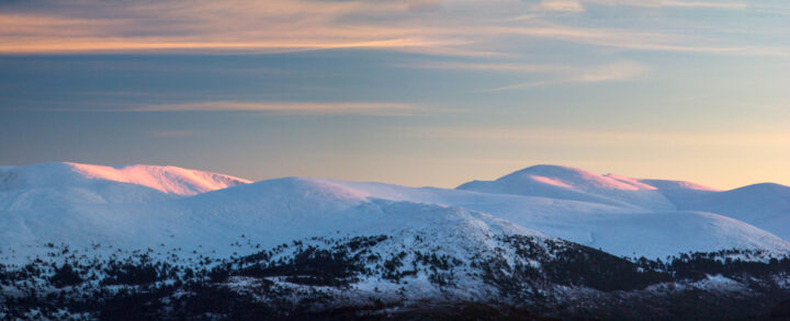 Last light on Braeriach and cairngorms, in winter snow turned pink